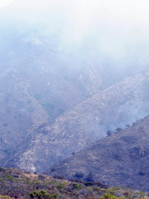 The blackened mountainsides of Garrapata Park after the Soberanes fire.