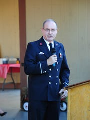 Farmington Hills Firefighter of the year James Neufeld speaks to the people in attendance at this years Patriot Day Ceremony.