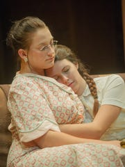 "Amanda Wingfield played by Ashleigh Dulik, left, comforts her daughter Laura Wingfield played by Tamarea Kramer during rehearsal for Tennessee Williams' ""The Glass Menagerie."""