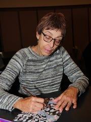 Redford resident Joan Lambert relaxes and enjoys a