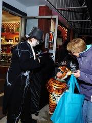 South Lyon Resale Shop employee Charlene Godfrey dressed