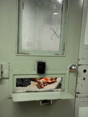 A prisoner sleeps during a mid-morning visit to the Monterey County Jail in Salinas.
