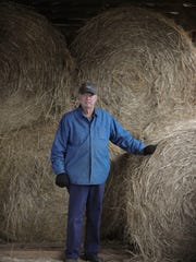 Don Regan visits the hay barn at his 66-acre Valley Farm on Thursday, Jan. 5, 2017, in West Knox County. Regan, who produces 300-350 bales a year, said the drought reduced his hay production about 25 percent.