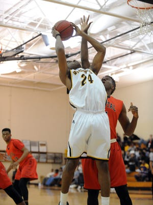 Oak Grove junior Noah Harris shoots for the basket  in a game against Petal on Friday.