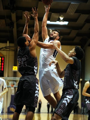 Hardin-Simmons' Duane Hopper (4) puts up a shot over McMurry's Luke Stephenson (32) during the first half of the Cowboys' 87-83 win on Saturday, Jan. 21, 2017, at HSU's Mabee Complex.