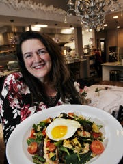 Gwendolyn Zero, owner of Wicked's Brew, dispalys the farmers market bowl with an egg. The restaurant is a beautiful setting with unusual decorative accents, communal tables, espresso bar, gift shop items, fabulous deserts and much more.