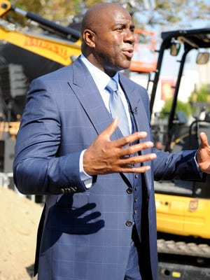 LAFC investor Magic Johnson speaks with media before groundbreaking ceremonies at Los Angeles Football Club Stadium Site. The venue will be named Banc Of California Stadium.