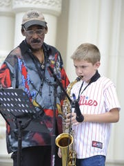 Musician Harry E. Spencer Jr. with student Joey Davis performing outside The Grand in 2008.
