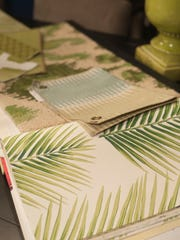 Nature is the inspiration for green accents on wallpaper samples at Modern Vintage Home in Cherry Hill.