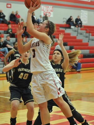 Jenna Karl drives to the hoop to put up a shot against Sandusky St. Mary Central Catholic.