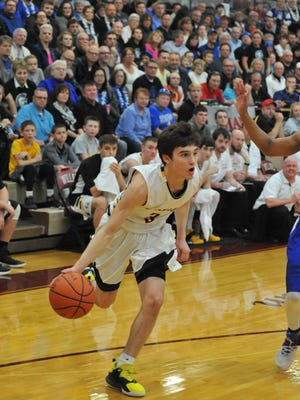 Jordan Fenner drives to the hoop against St. Peter's in the district final.