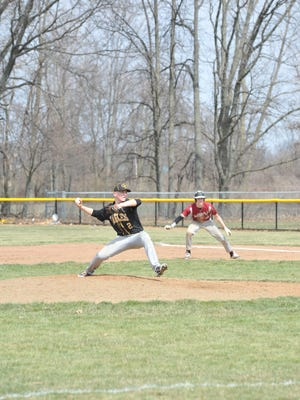 Noah Thoman pitches in the Eagles' second win of the day.