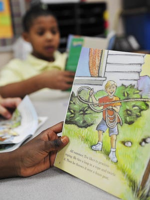 File photo of students reading a book at A.Z. Kelley Elementary school Monday, Dec. 14, 2015 in Nashville, Tenn.