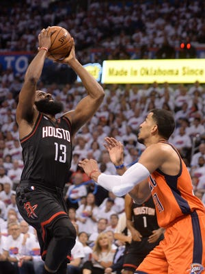 Houston Rockets guard James Harden (13) shoots the ball over Oklahoma City Thunder forward Andre Roberson (21) during the second quarter in game four of the first round of the 2017 NBA Playoffs at Chesapeake Energy Arena.