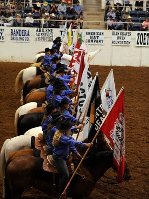 Cowgirls bring in the flags during the ranch rodeo at the Western Heritage Classic.