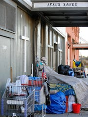 Homeless possessions lined up against the front of