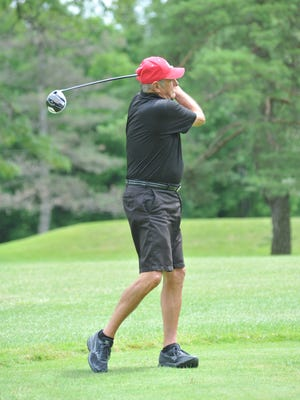 Jim Bradshaw, former Pittsburgh Steeler, tees off at the 10th hole at Marion Country Club.