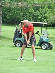 Former Ohio State University basketball player Rick Smith lines up his shot on the 10th hole at Marion Country Club.
