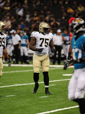 In this 2012 file photo New Orleans Saints defensive lineman Tyrunn Walker lines up for a play against the Jacksonville Jaguars offense during the preseason game in the Mercedes-Benz Superdome on Friday, Aug. 17, 2012.