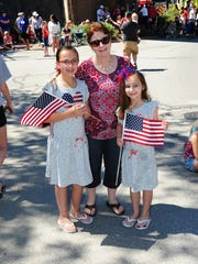 Highland residents Emily Nowacki, grandmother, Patty Dunstan and sister Chose decked out in their red, white and blues at the annual 4th of July Parade held in Milford.