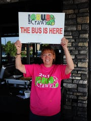 A Canton Grub Crawl volunteer lets everyone know that