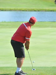 Buckeye Central's Adam Krebs putts from the fringe