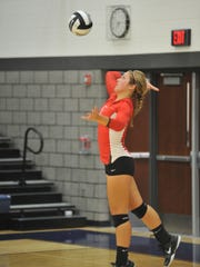 Jenna Karl serves in the second game against Carey.