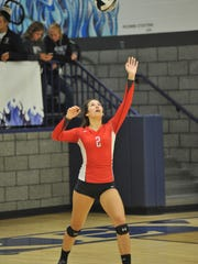 Emily Stump serves in the third game against Carey.