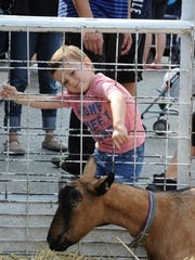 Samuel Sofroni of Canton enjoys the petting zoo at this year's Heritage Festival in downtown Northville.