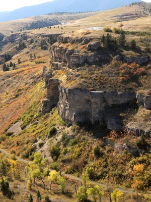 The cliffs of the Sluice Boxes State Park turn red and yellow with fall foliage.