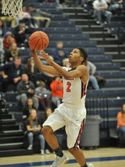 Galion's Zhamir Anderson goes up for a layup.