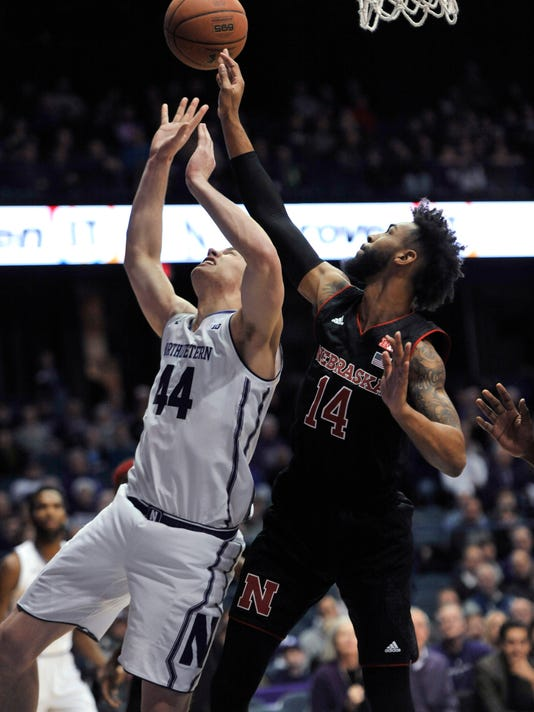 Northwestern's Gavin Skelly (44) and Nebraska's Isaac Copeland (14) vie a rebound during the first half of an NCAA college basketball game Tuesday, Jan. 2, 2018, in Rosemont, Ill. (AP Photo/Paul Beaty)