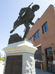 'Over the Top,' a Doughboy memorial with an honor roll