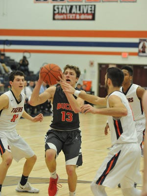 Buckeye Central's Max Loy drives to the basket with Galion's Isaiah Alsip defending him.