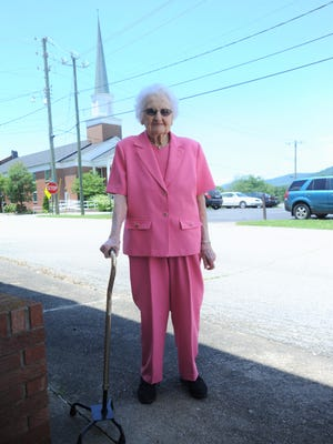 Weeks before her 100th birthday, Ruth Penland stands outside of the funeral home she opened in Swannanoa with her late husband George in 1976. Swannanoa First Baptist Church, which will be the site of her birthday celebration on Saturday, June 23, is right behind her.