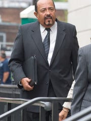 Former New Jersey state Sen. Wayne Bryant enters the Federal Courthouse in Trenton for sentencing after being convicted on all corruption charges against him.