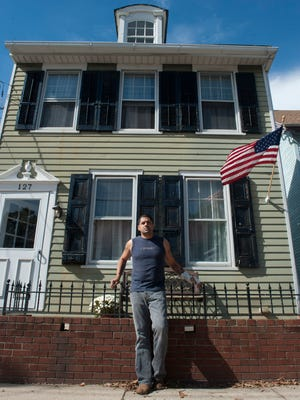 Military veteran Serafin Perez at his new home in Mt. Holly found for him with the help of a program called Soldier's On. Thursday, October 9, 2014.