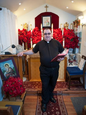 Father Carmel Palidano, former priest at shuttered St. Rita's parish, records his homilies from the chapel at his home and posts them on YouTube. Thursday, January 8, 2014.