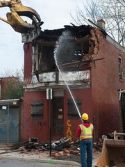 Demolition crew knocks down the building at 1510 Louis