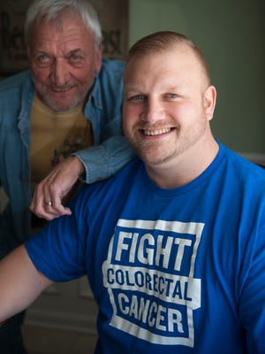 Colon cancer survivor Ed Yakacki, III, 36, sits with his father Ed Yakacki, Jr. Yakacki, who survived stage 4 cancer, will be featured on a 2016 calender to promote awareness about the disease. Wednesday, March 18, 2015.