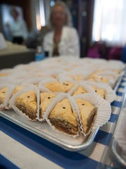 Volunteers serve authentic Greek pastries during the annual Greek Agora Festival at St. Thomas Greek Orthodox Church in Cherry Hill.