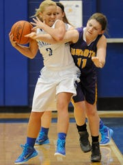 Unioto's Kaylee Valentine tries to steal the ball from