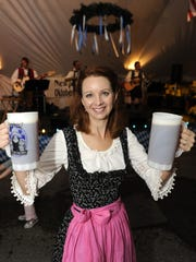 Anna Stukenborg of Newport, in a traditional Dirndl brings beers to her table at last year's Newport Oktoberfest.