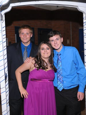 James Beaubien, Cierra Kenndy and Kyle Peace pose for a photo during their homecoming dance held at Redford Union Oct. 4.