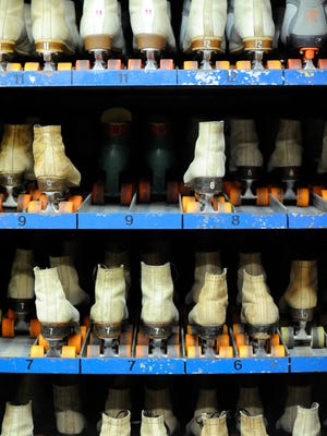 File - Roller skates await feet at the Rollaire Skate Center in Manitowoc.