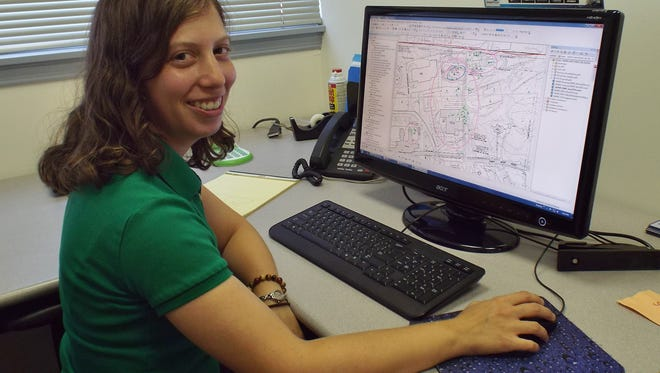 Stephanie LaRose Lewison, a geologist/geographic information systems specialist with PVE Sheffler in Poughkeepsie, works with others in the company to assess and clean contaminated sites. Lewison also serves as the company's GIS specialist, involving the use of mapping software.
