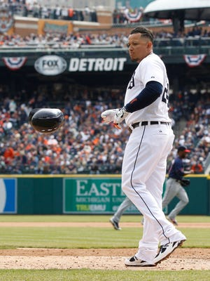 Detroit Tigers' Miguel Cabrera tosses his batting helmet after popping out to foul territory to end the seventh inning on Opening Day on Monday, April 6, 2015 in Detroit.