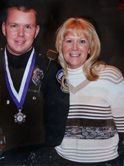 Indianapolis Metropolitan Police Department officer Dustin Carmack is shown with his mother Kim Carmack in this undated family photo. On April 17, 2014, Kimberlee Jo Carmack, also an IMPD officer, was fatally shot by her ex-husband, IMPD Sgt. Ryan Anders. After fatally shooting Carmack at her home on the Westside, Anders killed himselt.