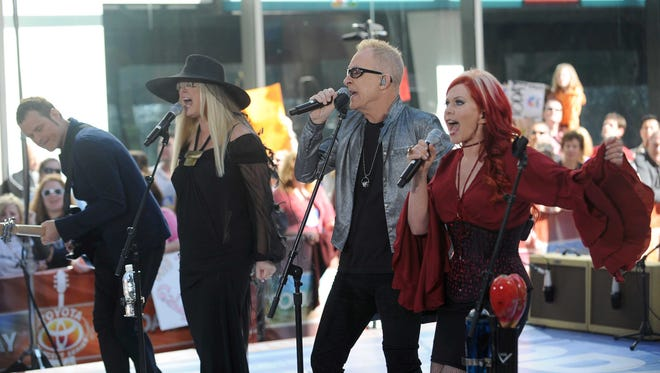 "Keith Strickland, Cynthia Leigh Wilson, Fred Schneider and Kate Pierson of the music group The B-52's perform live on NBC's ""Today"" Show on May 26, 2008 in New York City."
