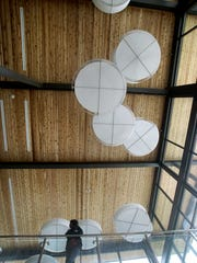 Circular lighting in the main entrance of the Marvin Williams Recreation Center.